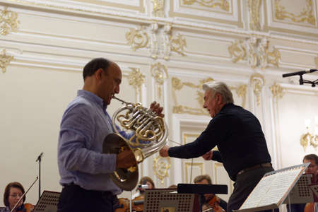 virtuoso: St. Petersburg, Russia - September 7, 2015: Virtuoso horn players Hermann Baumann (right) and Javier Bonet on the rehearsal with symphonic orchestra Nevsky during the International festival of French horn