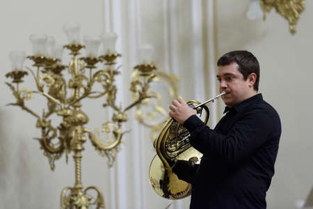 french horn: St. Petersburg, Russia - September 7, 2015: Musician of Choir of French horns on the rehearsal during the International festival of French horn. The hornfest is held 3rd time Editorial