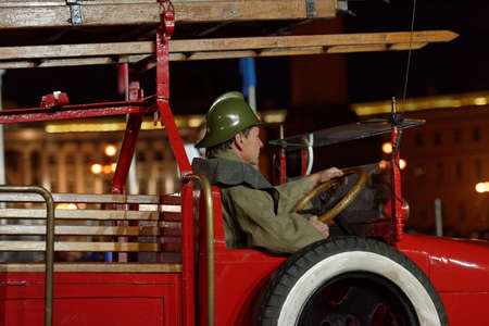 world championship: St. Petersburg, Russia - September 7, 2015: Actor in historic costume in the retro fire truck during the opening ceremony of the XI World Championship in Fire and Rescue Sport. First World Championship was held in 2002
