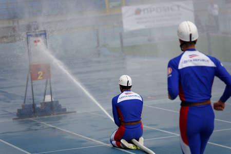 world championship: St. Petersburg, Russia - September 9, 2015: Team Czech Republic during competitions in combat deployment during the XI World Championship in Fire and Rescue Sport. First World Championship was held in 2002