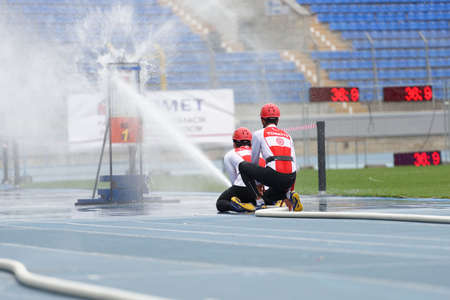 world championship: St. Petersburg, Russia - September 9, 2015: Team Turkey during competitions in combat deployment during the XI World Championship in Fire and Rescue Sport. First World Championship was held in 2002