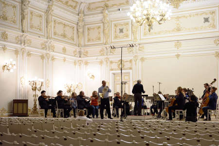 St. Petersburg, Russia - September 7, 2015: Virtuoso horn players, conductor Hermann Baumann and soloist Javier Bonet on the rehearsal with symphonic orchestra Nevsky during the International festival of French horn