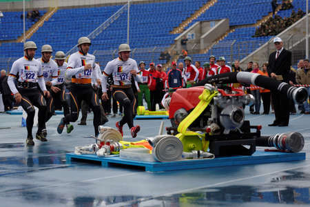 world championship: St. Petersburg, Russia - September 9, 2015: Team Germany during competitions in combat deployment during the XI World Championship in Fire and Rescue Sport. First World Championship was held in 2002 Editorial
