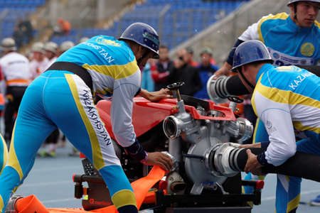 fire team: St. Petersburg, Russia - September 9, 2015: Team Kazakhstan during competitions in combat deployment during the XI World Championship in Fire and Rescue Sport. First World Championship was held in 2002