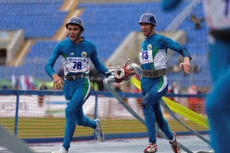 world championship: St. Petersburg, Russia - September 9, 2015: Team Uzbekistan compete in combat deployment during the XI World Championship in Fire and Rescue Sport. First World Championship was held in 2002
