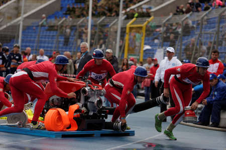 fire team: St. Petersburg, Russia - September 9, 2015: Team Poland during competitions in combat deployment during the XI World Championship in Fire and Rescue Sport. First World Championship was held in 2002 Editorial