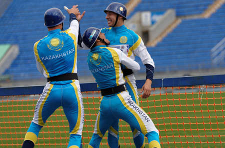 world championship: St. Petersburg, Russia - September 9, 2015: Team Kazakhstan celebrate good result in competitions in combat deployment during the XI World Championship in Fire and Rescue Sport. First World Championship was held in 2002 Editorial