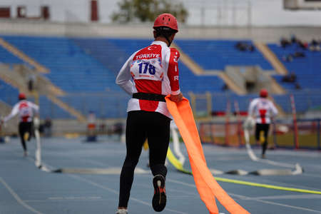 fire team: St. Petersburg, Russia - September 9, 2015: Team Turkey during competitions in combat deployment during the XI World Championship in Fire and Rescue Sport. First World Championship was held in 2002