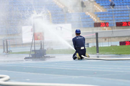 world championship: St. Petersburg, Russia - September 9, 2015: Athlete of team Korea competes in combat deployment during the XI World Championship in Fire and Rescue Sport. First World Championship was held in 2002 Editorial