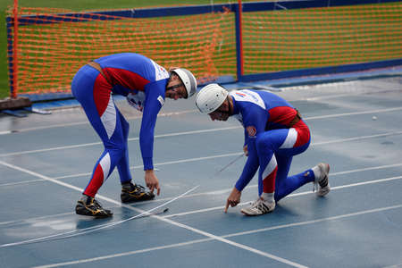 world championship: St. Petersburg, Russia - September 9, 2015: Team Czech Republic prepare for competitions in combat deployment during the XI World Championship in Fire and Rescue Sport. First World Championship was held in 2002 Editorial