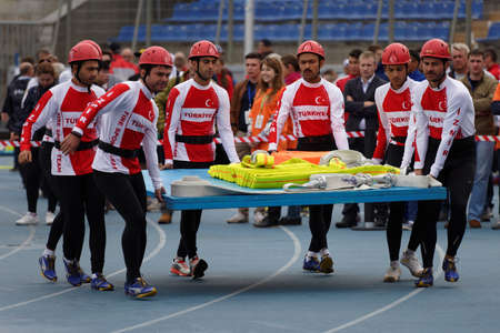 world championship: St. Petersburg, Russia - September 9, 2015: Team Turkey bring fire hoses before competitions in combat deployment during the XI World Championship in Fire and Rescue Sport. First World Championship was held in 2002 Editorial