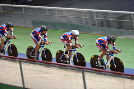 St. Petersburg, Russia - August 11, 2015: Unidentified riders compete in team race during Russian track cycling championship. Velodrome Lokosphinx hosts the competitions Editorial