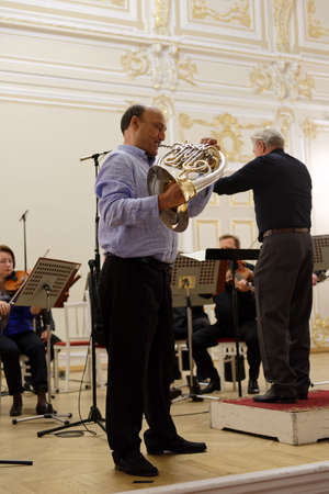 soloist: St. Petersburg, Russia - September 7, 2015: Conductor Hermann Baumann and soloist Javier Bonet on the rehearsal with symphonic orchestra Nevsky during the International festival of French horn Editorial