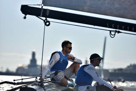 igor: St. Petersburg, Russia - August 22, 2015: Skipper of Gazprom Team Igor Lisovenko (left) and trimmer Alexander Bozhko of Russia on the catamaran during the 3rd day of St. Petersburg stage of Extreme Sailing Series. The Wave, Muscat team of Oman leading aft