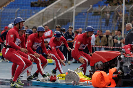 world championship: St. Petersburg, Russia - September 9, 2015: Team Poland during competitions in combat deployment during the XI World Championship in Fire and Rescue Sport. First World Championship was held in 2002 Editorial