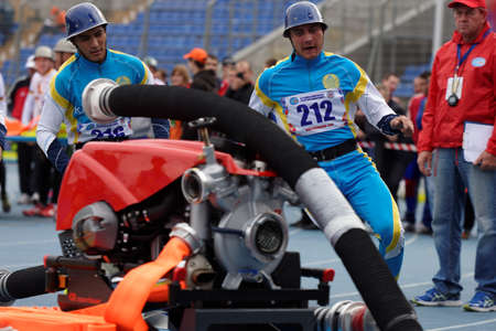 world championship: St. Petersburg, Russia - September 9, 2015: Team Kazakhstan during competitions in combat deployment during the XI World Championship in Fire and Rescue Sport. First World Championship was held in 2002