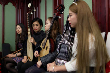 pipa: St. Petersburg, Russia - September 14, 2015: Womens chamber orchestra Beauty and Melody of Sichuan province during press cocktail. The event is part of the Festival of Chinese music