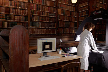 digitization: St. Petersburg, Russia - September 16, 2015: Tatiana Tychina from scanning department of Presidential library performs digitization of collection of St. Petersburg State University�s scientific library. The project aimed to make unique documents available