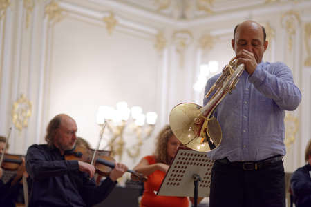 symphonic: St. Petersburg, Russia - September 7, 2015: Javier Bonet on the rehearsal with symphonic orchestra Nevsky during the International festival of French horn. The hornfest is held 3rd time Editorial