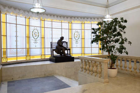 composers: St. Petersburg, Russia - September 7, 2015: Sculpture of Russian composer M. I. Glinka at the main staircase of the Small Hall of Saint-Petesburg Philharmonia. The Small Hall named after Glinka
