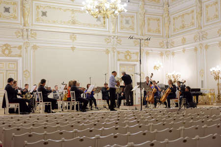 virtuoso: St. Petersburg, Russia - September 7, 2015: Virtuoso horn players, conductor Hermann Baumann and soloist Javier Bonet on the rehearsal with symphonic orchestra Nevsky during the International festival of French horn
