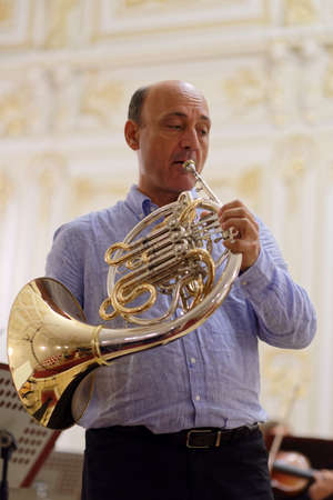 french horn: St. Petersburg, Russia - September 7, 2015: Javier Bonet on the rehearsal with symphonic orchestra Nevsky during the International festival of French horn. The hornfest is held 3rd time Editorial