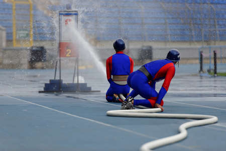 world championship: St. Petersburg, Russia - September 9, 2015: Team Mongolia during competitions in combat deployment during the XI World Championship in Fire and Rescue Sport. First World Championship was held in 2002 Editorial