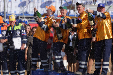 award ceremony: Novopriozersk highway, Leningrad oblast, Russia - September 11, 2015: Winners with prizes during award ceremony of the final part of Russian professional skills championship of road workers. Rosavtodor joined Worldskills Russia this year Editorial