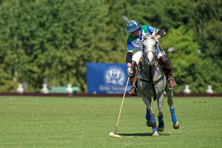 Tseleevo, Moscow region, Russia - July 26, 2014: Esteban Panelo of Moscow Polo club in action in the match against the team of British Schools during the British Polo Day. Moscow Polo Club won 7-6 Editorial