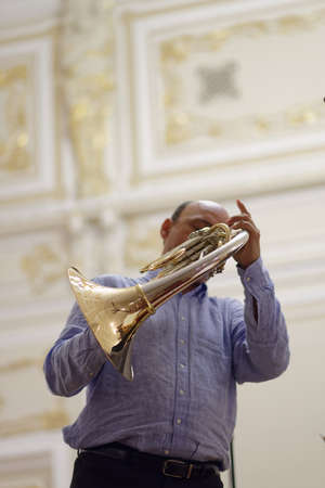 french horn: St. Petersburg, Russia - September 7, 2015: Javier Bonet on the rehearsal during the International festival of French horn. The hornfest is held 3rd time Editorial