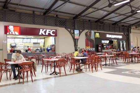 fast food restaurant: St. Petersburg, Russia - August 29, 2015: Food court in the shopping mall Varshavsky Express. The mall was established in 2006 in the former building of the Varshavsky Railway Station