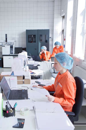 pharmaceutical plant: St. Petersburg, Russia - September 24, 2015: Staff working in the microbiological laboratory on the Solopharm plant. The new modern pharmaceutical plant was built in accordance with Good Manufacturing Practice standards Editorial