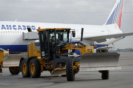 grader: St. Petersburg, Russia - September 24, 2015: Motor grader Deere 672g during the annual review of equipment in the Pulkovo airport. The review is held in order to prepare to winter