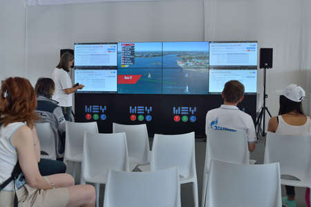 st german: St. Petersburg, Russia - August 22, 2015: People watching the race using the SAP software during the St. Petersburg stage of Extreme Sailing Series. German SAP SE is the official technical partner of the Series Editorial