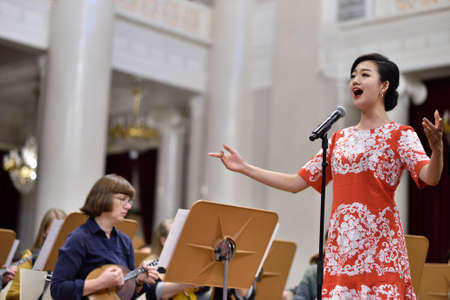 yui: St. Petersburg, Russia - October 6, 2015: Soprano Yui Don Ni from Star Sopranos of China on the rehearsal with the Andreyev State Russian Orchestra in the Philharmonic Hall. The event is part of the Festival of Chinese music