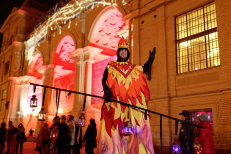 music hall: St. Petersburg, Russia - October 8, 2015: Man on stills against the illuminated facade of Music Hall during LumiFest. It was the first festival of light culture in Russia Editorial