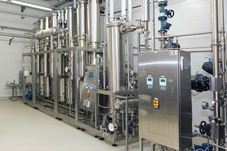 pharmaceutical plant: St. Petersburg, Russia - September 24, 2015: Water purification equipment on the Solopharm plant. The new modern pharmaceutical plant was built in accordance with Good Manufacturing Practice standards