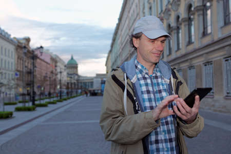 and st petersburg: Mature tourist with a tablet in St. Petersburg, Russia Stock Photo