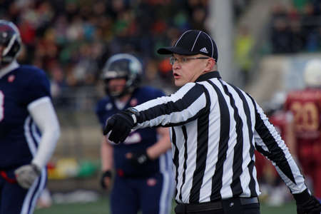 european championship: Pushkin, Leningrad oblast, Russia - October 10, 2015: Referee during the qualifying match of American Football European Championship 2016 Russia vs Norway. Russia won the match 20:0