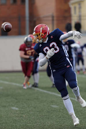 european championship: Pushkin, Leningrad oblast, Russia - October 10, 2015: Player of team Norway fight for the ball during the qualifying match of American Football European Championship 2016 against Russia. Russia won the match 20:0