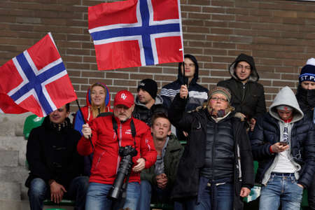 football european championship: Pushkin, Leningrad oblast, Russia - October 10, 2015: Norwegian fans support their team during the qualifying match of European Championship 2016 in American football. Russia won the match 20:0