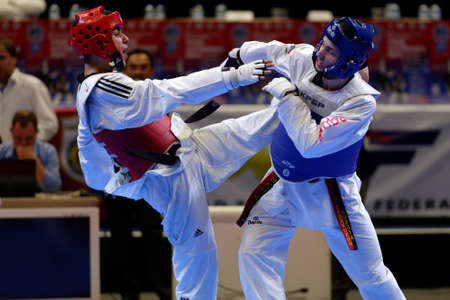 cup of russia: St. Petersburg, Russia - October 17, 2015: Taekwondo WTF junior teams match Russia vs Iran during the martial arts festival Baltic Sea Cup in Sibur Arena. The traditional festival is organized by martial arts school of Demid Momot