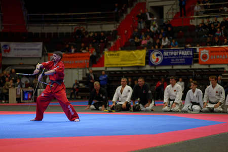 nunchaku: St. Petersburg, Russia - October 17, 2015: Demonstration performance with nunchaku from the St. Petersburg Kobudo Federation during the martial arts festival Baltic Sea Cup in Sibur Arena. The traditional festival is organized by martial arts school of De Editorial
