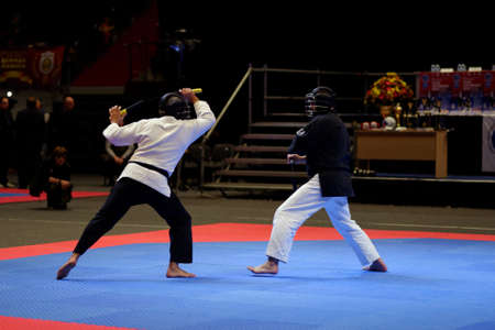 nunchaku: St. Petersburg, Russia - October 17, 2015: Demonstration performance of nunchaku fighters from the St. Petersburg Kobudo Federation during the martial arts festival Baltic Sea Cup in Sibur Arena. The traditional festival is organized by martial arts schoo Editorial