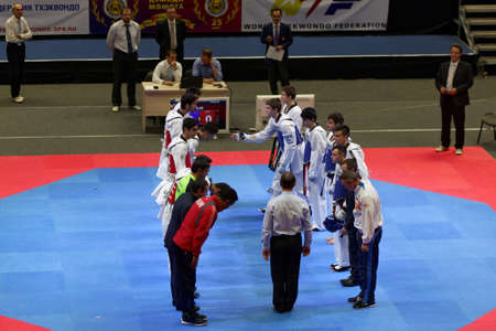 salutation: St. Petersburg, Russia - October 17, 2015: Junior team salutation before the match Russia vs Iran during the martial arts festival Baltic Sea Cup in Sibur Arena. The traditional festival is organized by martial arts school of Demid Momot Editorial