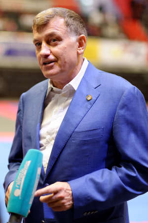 legislative: St. Petersburg, Russia - October 17, 2015: Chairman of Legislative Assembly of St. Petersburg Vyacheslav Makarov talks with press during the martial arts festival Baltic Sea Cup in Sibur Arena. The traditional festival is organized by martial arts school
