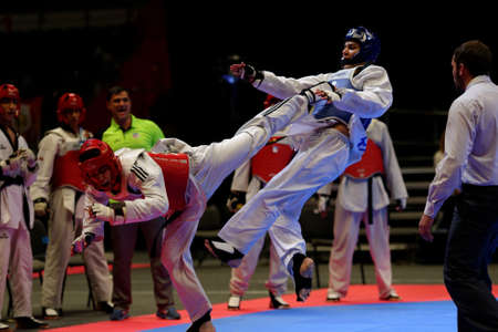 match: St. Petersburg, Russia - October 17, 2015: Taekwondo WTF junior teams match Russia vs Iran during the martial arts festival Baltic Sea Cup in Sibur Arena. The traditional festival is organized by martial arts school of Demid Momot
