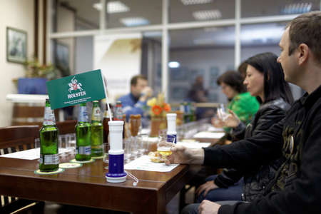 carlsberg: St. Petersburg, Russia - October 24, 2015: Tourists during tasting session at the Baltika - St Petersburg brewery. This session is a part of the October Beer Festival celebrations Editorial