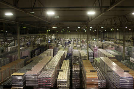 carlsberg: St. Petersburg, Russia - October 24, 2015: Finished production warehouse at the Baltika - St Petersburg brewery during the October Beer Festival. The brewery provides guided tours to the plant regularly Editorial