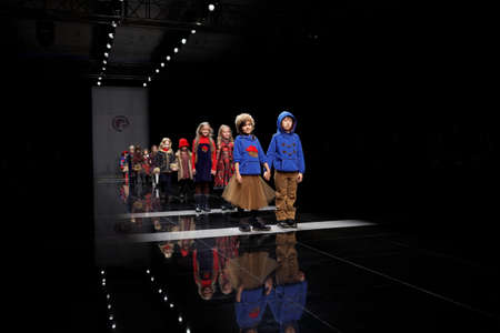 fashion show: St. Petersburg, Russia - October 27, 2015: Children collection of young designers at the fashion show during Mercedes-Benz Fashion Day St. Petersburg. It is one of the most popular fashion events of the city Editorial